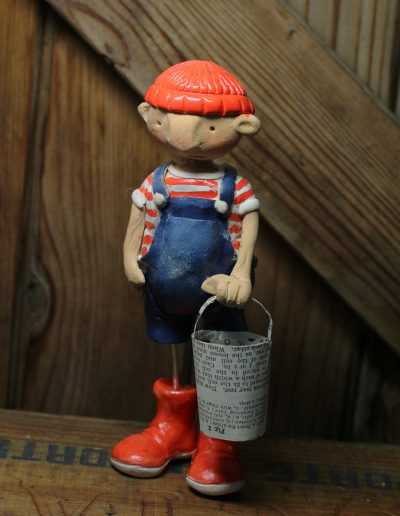 Ceramic character titled Goin' crabbin, sculpted by Traci Howard