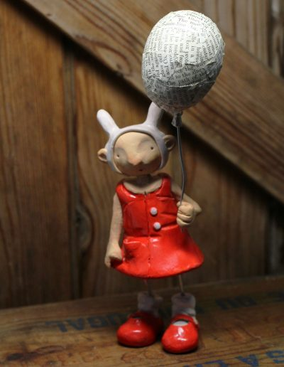 Vintage seaside sculpture titled Matilda and the balloon by Traci Howard