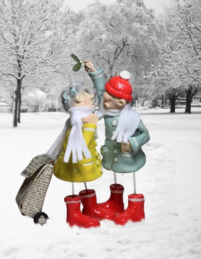 clay sculpture titled Bernard and Mildred kissing in the snow by Traci Howard