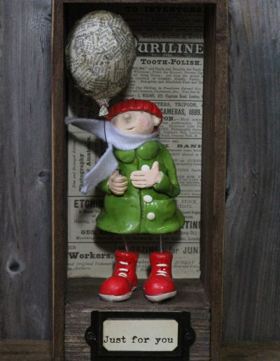 Ceramic sculpture titled Filbert and the balloon by Traci Howard